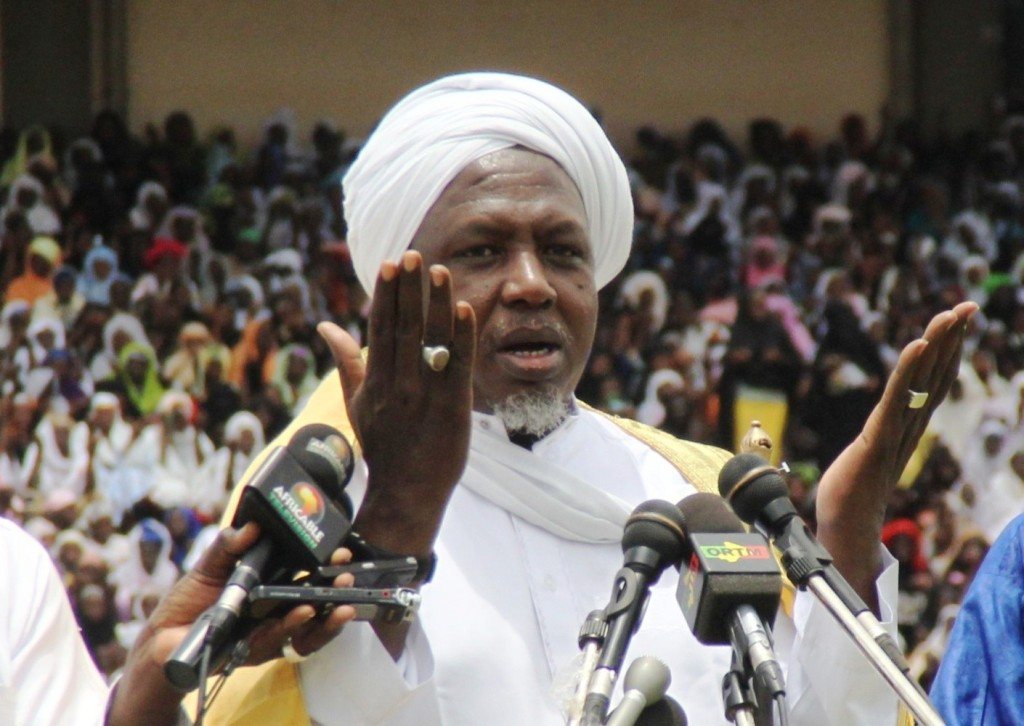 "Mahmoud Dicko (C), head of Mali's High Islamic Council prays on August 12, 2012 in Bamako during a giant peace rally in Mali. Up to 60,000 people gathered Sunday for a giant peace rally in Mali, a country split in two after Islamists wrested control of northern desert regions after a March coup in the capital Bamako.  The meeting for ""national peace and reconciliation"" in Bamako's main stadium was called by the country's top Muslim body and drew several key politicians including Prime Minister Cheikh Modibo Diarra. AFP PHOTO / HABIBOU KOUYATE        (Photo credit should read HABIBOU KOUYATE/AFP/GettyImages)"