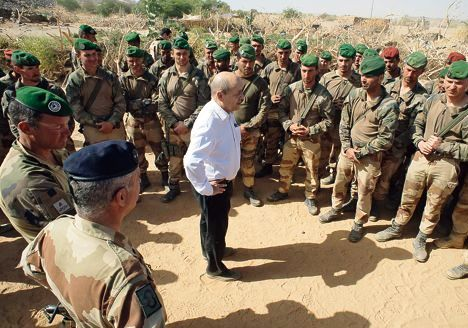 """France's minister of defence Jean-Yves Le Drian (C) speaks to French troops in the northern Malian region of Ifoghas on March 7, 2013.  The ministry said Le Drian started his visit in the Amettetai valley in the Ifoghas mountains, where French and Chadian troops have been hunting down rebels driven from northern Mali's main cities by a lightning intervention launched in mid-January.  AFP PHOTO / EMA-ECPAD /  ARNAUD ROINE RESTRICTED TO EDITORIAL USE - MANDATORY CREDIT """"AFP PHOTO / EMA-ECPAD / ARNAUD ROINE """" - NO MARKETING NO ADVERTISING CAMPAIGNS NO ARCHIVES - DISTRIBUTED AS A SERVICE TO CLIENTS - TO BE USED WITHIN 30 DAYS FROM MARCH 7, 2013"""