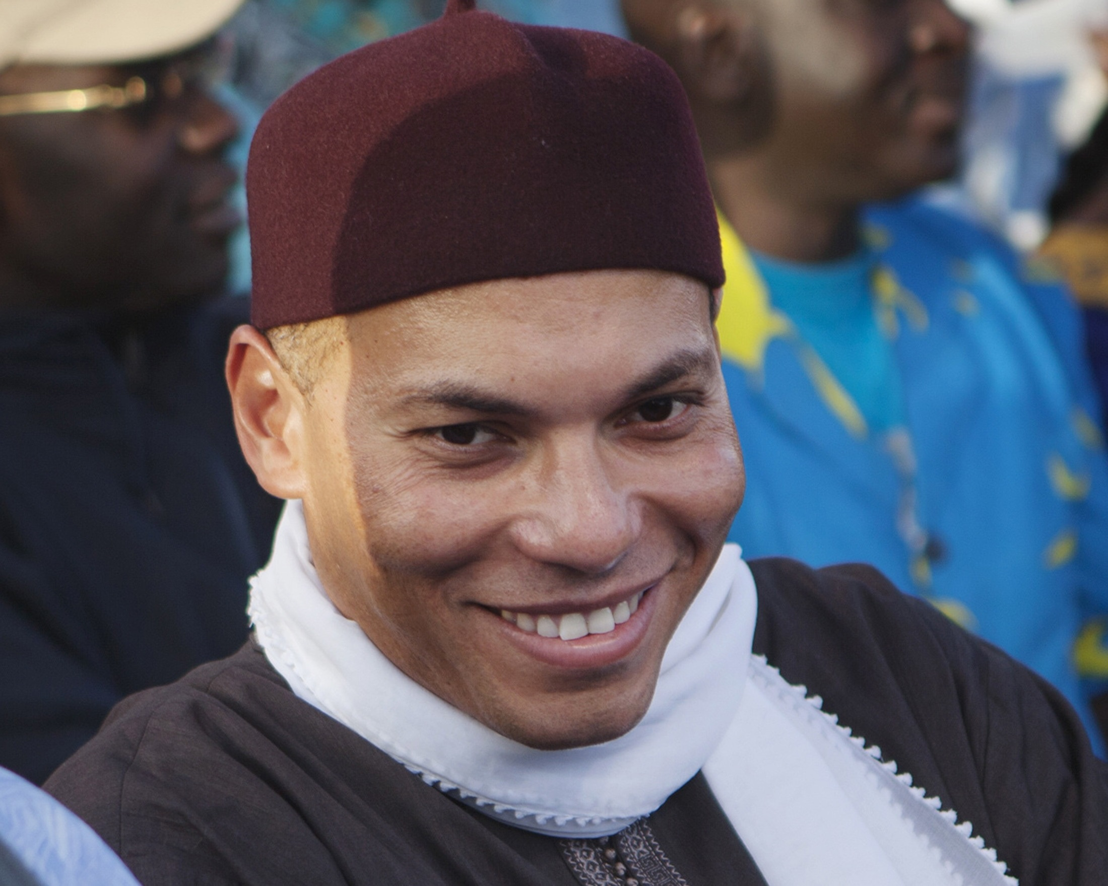 Karim Wade (C), son of Senegal's former president Abdoulaye Wade, attends a rally of his father's political party Parti Democratique Senegalais (PDS) in Dakar, in this file picture taken December 6, 2012. Senegalese police arrested Karim Wade on April 15, 2013 on suspicion of illegally amassing some $1.4 billion during his father's tenure, his lawyers said.       REUTERS/Joe Penney/Files (SENEGAL - Tags: POLITICS)